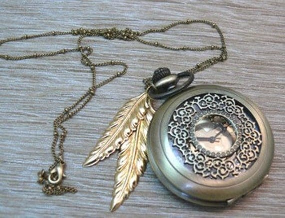 Pocket watch with golden feather