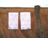 Super girly pink patterned tea towel with eyelet trim
