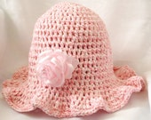 light pink and off white hand crochet cotton hat for toddler with a pink rose hair clip