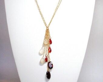 "garnet cz and moonstone 38"" opera length gold necklace"