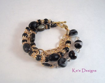 black agate, obsidian and onyx 3 strand gold bracelet, size 7.5