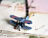 in flight. airplane necklace. USA flag theme