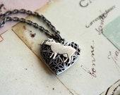 loves cows. locket necklace.silver ox color