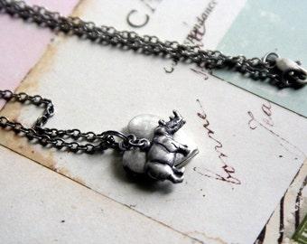 rhino. heart locket necklace. silver ox