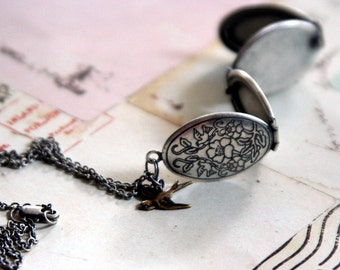 bird floral. locket necklace. silver ox with 4 photo slots in the locket