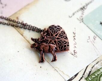 moose. locket necklaces.copper ox