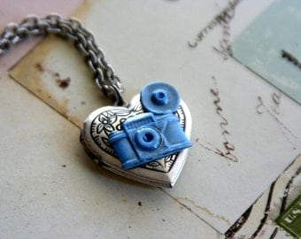 loves photography. camera locket necklace. baby blue and silver ox