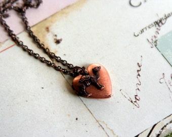 camel. heart locket necklace. copper ox
