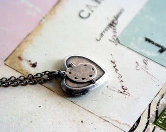 painter. locket necklace. in silver ox