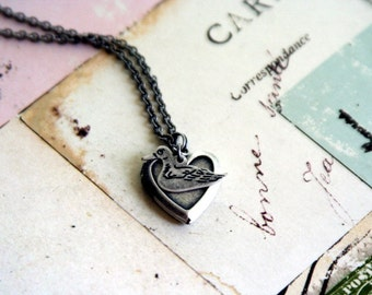 duck. locket necklace. in silver ox