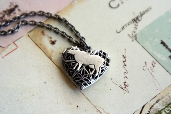 loves cows. locket necklace.silver ox color