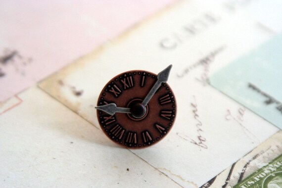 clock ring locket. time piece in copper ox