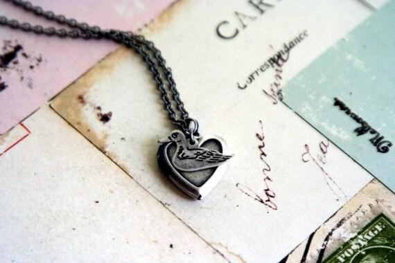 duck. locket necklace. in silver ox