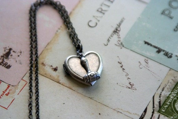 judge. heart locket necklace. silver ox