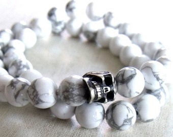 Silver charm on Howlite stone wrap.