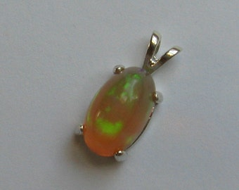 12MM x 8MM oval cabochon cut 2.83 ct Ethiopian crystal opal sterling silver pendant with baby box chain