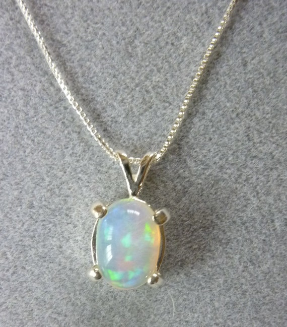 10mm x 7mm oval 1.87 ct Ethiopian crystal opal sterling silver pendant with baby box chain