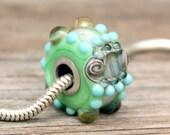 Continue- A European Charm glow-in-the-dark lampwork bead