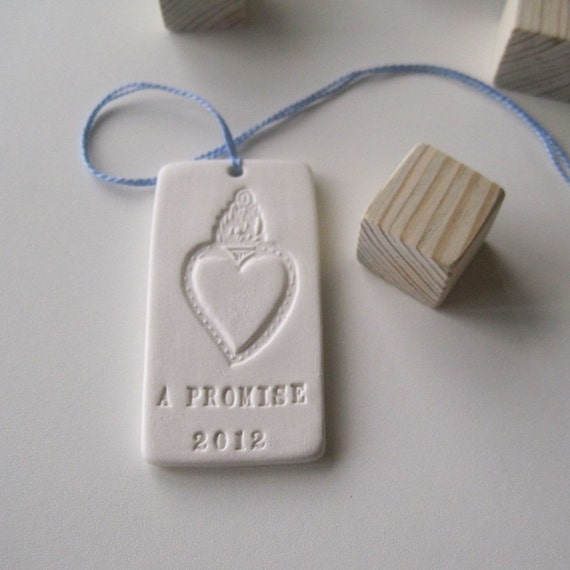 A PROMISE bridal bouquet text tile charm in porcelain with commemorative year 2012
