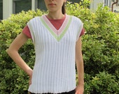 Tunic Tennis Vest, twisted stitches replace traditional cables in this sweater vest. PDF knitting pattern