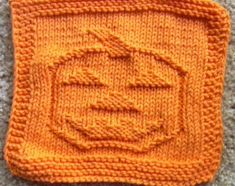 Orange pumpkin knit dishcloth, orange pumpkin knit wash cloth, halloween dishcloth. Jack-o-lantern dishcloth, jackolantern dishcloth.