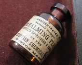 Reproduction vintage Egyptian Chemical Company Embalming Fluid miniature glass bottle charm