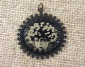 Silent film vamp Alla Nazimova portrait filigree aged brass and resin pendant
