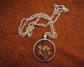 glass encased dandelion necklace