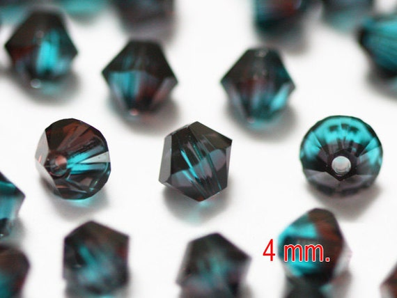 50 pcs. Burgundy Blue Zircon Blend Swarovski Crystal Bicone 4 mm.