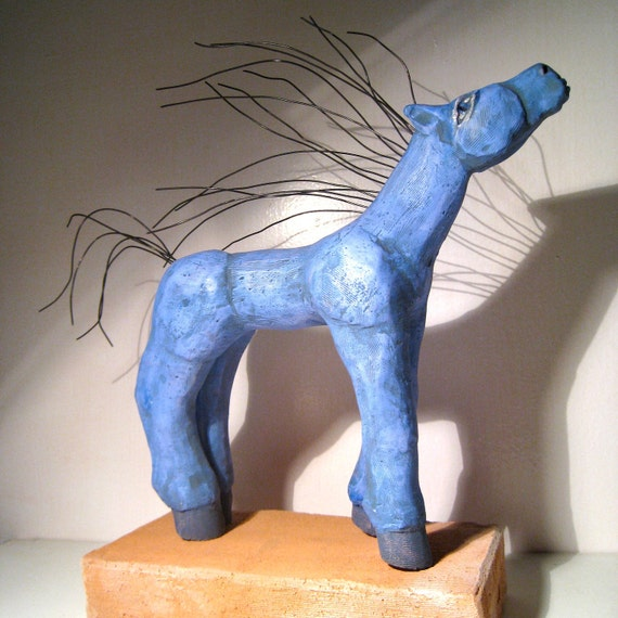 Blue Horse with a Wild Hair standing up at the edge where this moment meets her heart.