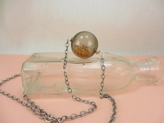 Orb. Glass bubble and mustard seed necklace