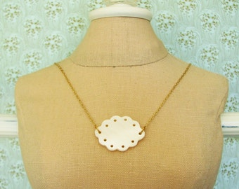 Eyelet . Mother of Pearl, Fine Brass, and Pretty Scallops