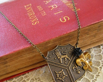 Herald . Brass Crest, Fleur de Lis, and Black Rose