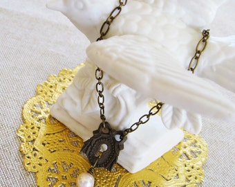 Secret . Beribboned Escutcheon, Ivory Pearl, and Vintage Charm