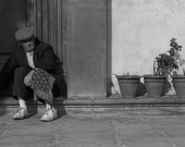 Man With Handkerchief Sitting By Flowerpots In Florence