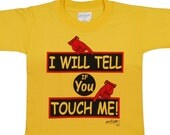 YOUR VOICE CAN HELP SAVE A CHILD WHO IS TOO FRIGHTENED TO SPEAK FOR HIMSELF   I Will Tell if You Touch Me  -  An Alert Shirt