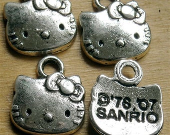 c5  hello kitty charm tibet silver quantity six  measures  12 x 15 mm  cat face with little bow cute