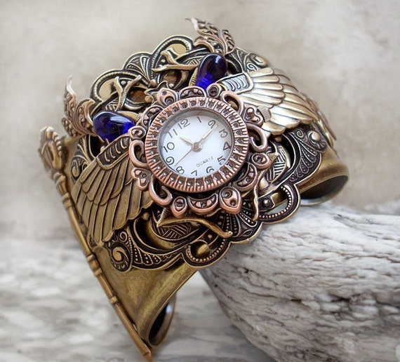 Steampunk Watch Cuff - Egyptian Brass theme, blue glass, Scarab
