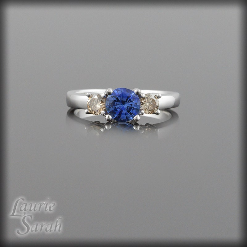sapphire engagement ring light blue sapphire and chagne