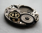 small steampunk brooch with sheet music