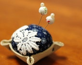 Leather bottom pincushion with two cute pins