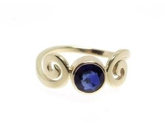 Blue Sapphire In 14K Gold Swirl Ring