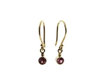 Pink sapphire earrings set in 14k gold