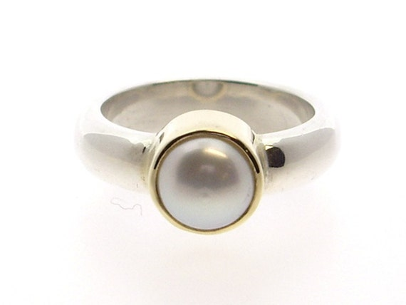 Pearl Set In Gold Bezel With Silver Band