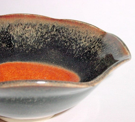 Wheel thrown pottery bowl with scalloped rim in black and brown with golden speckles