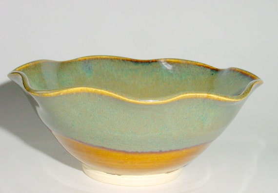 Scalloped Pottery Bowl in Amber with Sage Green and Blue around the Rim