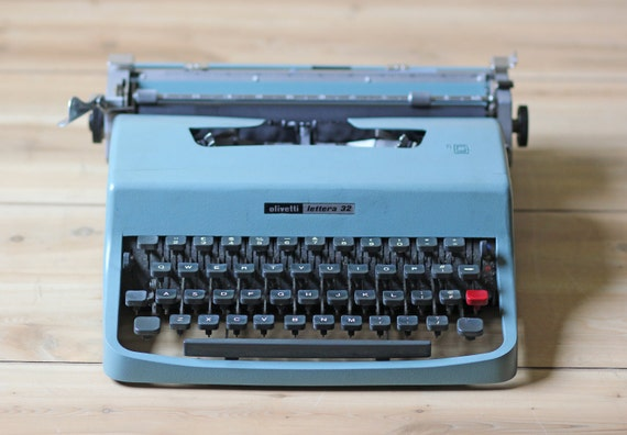 teal Olivetti Lettera 32 typewriter with case
