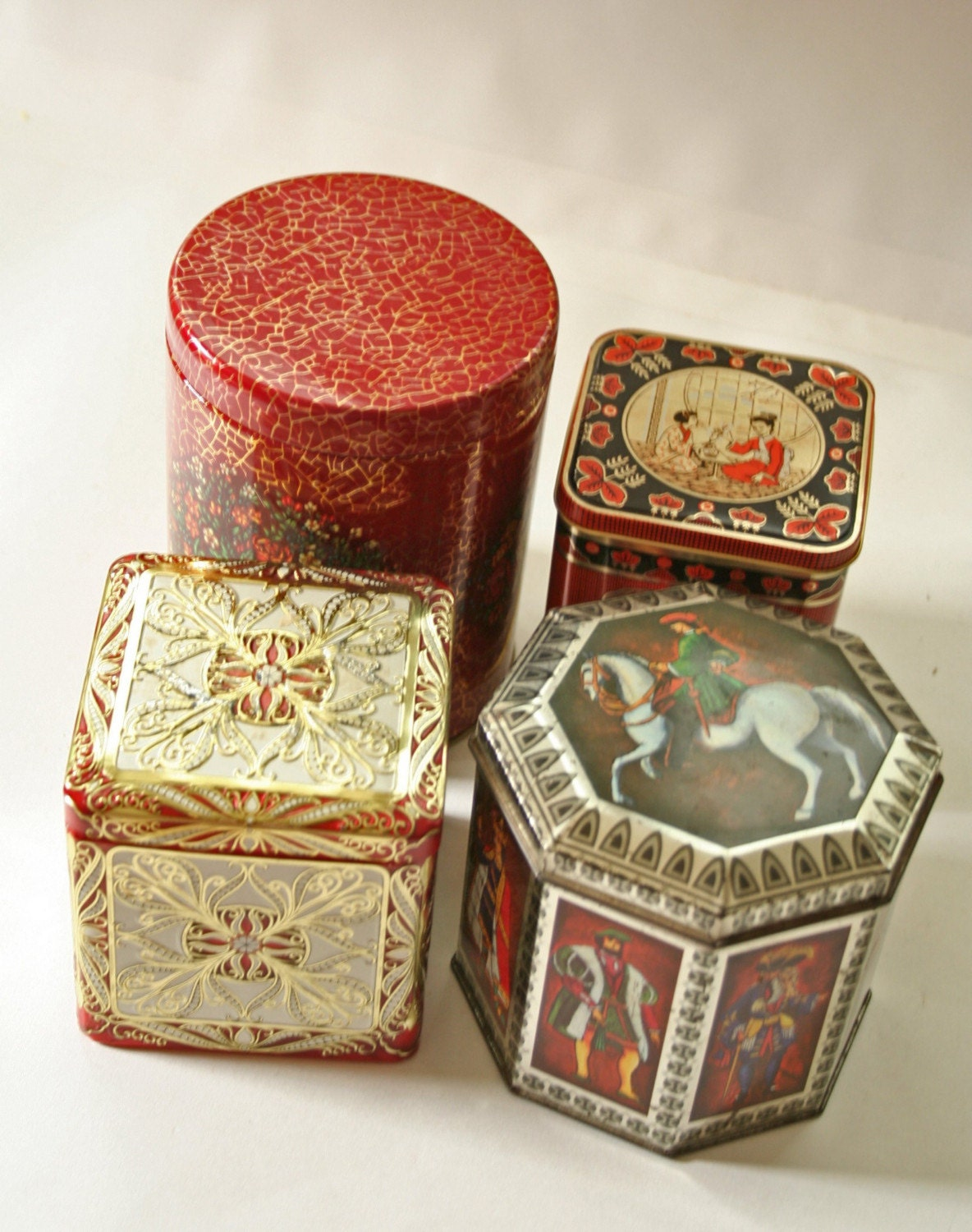 set of 4 vintage decorative tins dark red and black