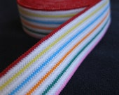 rainbow striped white elastic, with yellow, blue, red, green, pink, and orange stripes, 11/16 inch wide