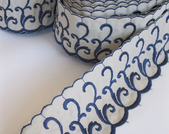"Embroidered scalloped trim in dark blue and beige, scroll work design, 3"" wide"